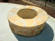 Stone Outdoor Fire Pit with Retaining Wall